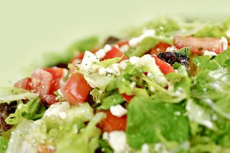 Healthy Vegetables Salad Closeup Horizontal Photo. Light Green Background. photo