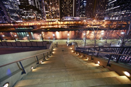 Stairs to Riverwalk in Chicago, IL USA. Chicago River and Skyscrapers at Night. Horizontal WIde Angle Photography. Stock Photo - 12789673