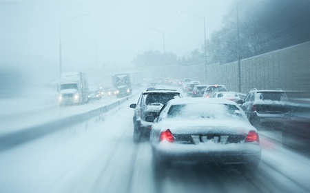 road conditions: Winter Storm Traffic. I-294 Chicago Highway During Snow Storm. Heavy Snowfall and Heavy Traffic.