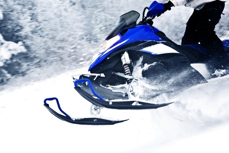 Snowmobile in Action - Extreme Winter Snow Fun  Transportation and Life Style Photo Collection  Snowmobile Horizontal Photo  Editorial