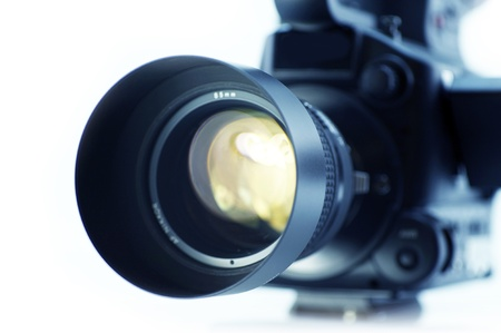 Video Camera Lens  - Video Optics. Videography Equipment. 43 Sensor Video Camera Isolated on White. Focus on the Lens. Stock Photo