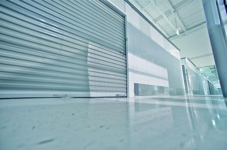 Storage Facility - Storage Hallway  Storage Lockers - Units  Wide Angle Floor Level Photography Stock Photo - 12787633