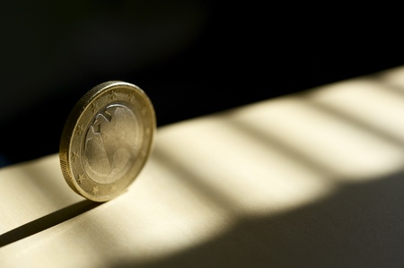 Rolling Euro Coin in the Spot Light  Business Theme Photography  photo
