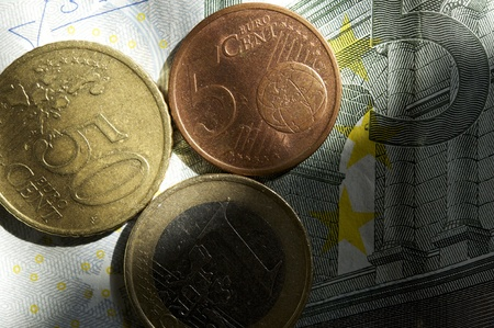 Euro Money New Light - New Day for European Union Currency  Euro Coins on Euro Bill Business Photo Theme Stock Photo - 12787162