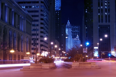 magnificent: Michigan Avenue After Dark - Chicago, Illinois USA. Michigan Avenue is a Major North-South Street in Chicago. Michigan Avenue and The Magnificent Mile Straight Ahead. Long Exposure Photography.