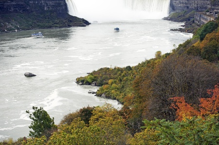 tour boats: Niagara International Falls in October  Two Tour Boats on the Niagara River