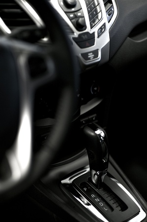 Vehicle Transmission Stick with Chrome Decoration Elements. Modern Vehicle Interior. photo