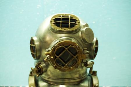 under pressure: Vintage Deep Sea Diver Metal Helmet. Vintage Diving Equipment. Horizontal Photography. Editorial