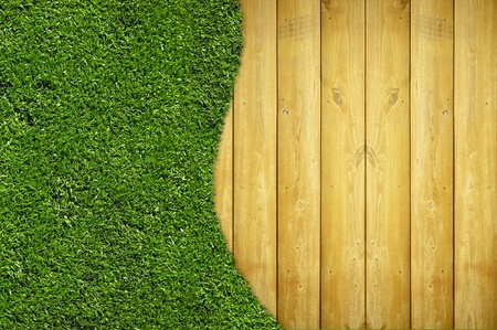 Wood Planks and Grass - Home & Garden Background with Realistic Grass Field and Real Vertical Wood Planks Stock Photo