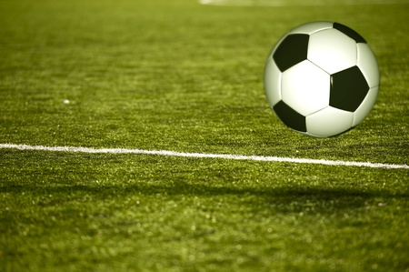 soccer field: Soccer Field. European Football Theme with Grassy Soccer Field and Traditional Black and White Foot Ball near Ground Touch. Sport Illustrations Collection Stock Photo