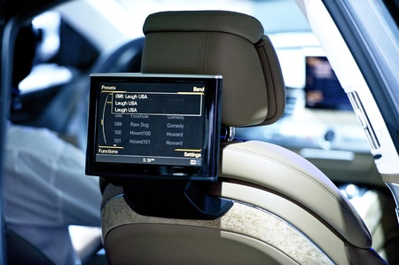 vehicle seat: Back Seat Car Display - Car Audio-Video Theme. Back Seat Video Screen Closeup. Technology Photo Collection.
