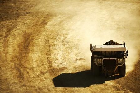 Huge Dump Truck in the Mining Area