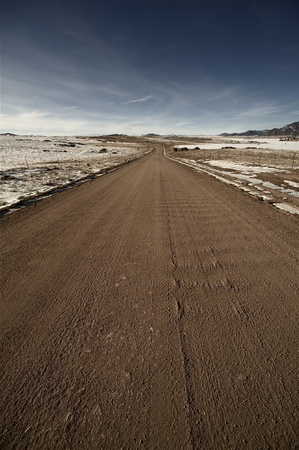 Sandy Road in Colorado. February near Colorado Springs, Colorado USA. Eleven Miles State Park Stock Photo - 13227002