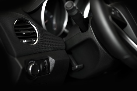 Dark Car Interior - Steering Wheel and Dashboard. Door Side. Modern Vehicle Interior Photo. photo
