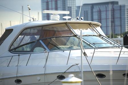 closeout: Luxury Boat Docked in City Harbor. Horizontal Photo - Boat Closeout. Stock Photo