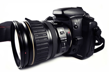 photo shooting: Digital SLR Camera  DSLR Professional Camera with Zoom Lens Isolated on White. Black Body PRO Camera.