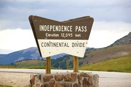rocky mountains colorado: Independence Pass Wood Sign. Elevation 12,095. Continental Divide. East from Aspen. Colorado USA. Stock Photo