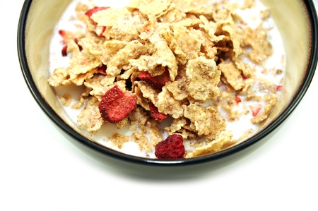 Fresh Corn Flakes with Strawberries in Milk. Healthy Breakfast. White Separated Background.