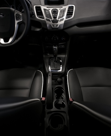 holder: Dark Modern Vehicle Interior - Wide Angle Photography. Dark Leather Seats and Dash. Vertical Photo. Car Interiors Photo Collection