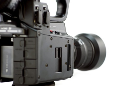filmmaking: Professional Camera - Side View. 35mm Lens. White Background. Isolated Photo. Filmmaking Photo Collection.