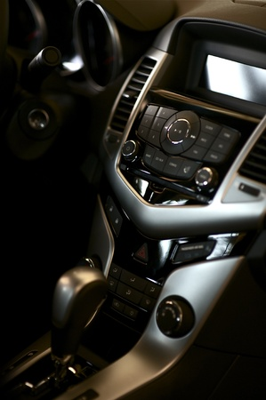 dark interior: Car Cockpit. Modern Vehicle Interior-Cockpit with Automatic Transmission Stick-Shift. Dark Interior with Silver Elements. Transportation Photo Collection.