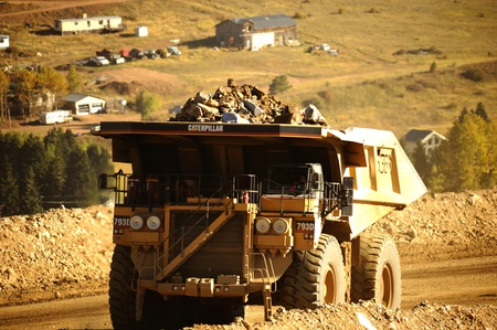 truck driver: HD Mine Truck. Gold Mine and Heavy Duty Truck with Large Stones.