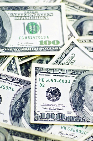 bank owned: American Dollar Bills. One Hundred Dollars Bills. Vertical Photo. Dollars Background