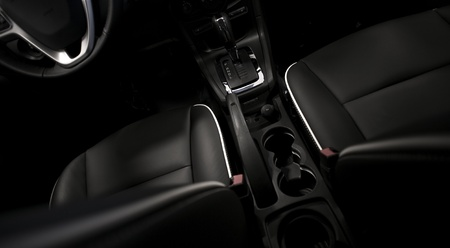 holders: Comfortable  Vehicle Black Leather Seats. Dark Modern Vehicle Interior. Transportation Photo Collection.
