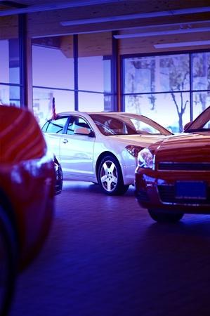 auto dealership: Car Dealer Showroom - Few Vehicles For Sale Exposition. Vertical Photo. American Dealership Showroom.
