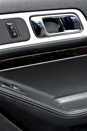 locks: Modern Vehicle Door Inside with Black Leather and Chrome Elements  Door Handler and Lock