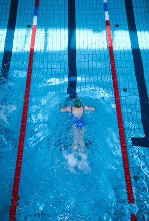 Young Female Swimmer in the Swimming Pool - Top View  Sports Photo Collection