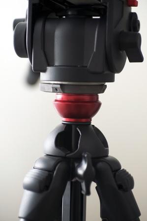 motion sensor: Camera Tripod. Black Body Videography or Photography Tripod - Head Section. Vertical Photo