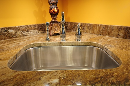 Silver Sink and Granite Countertop. Kitchen Interiors