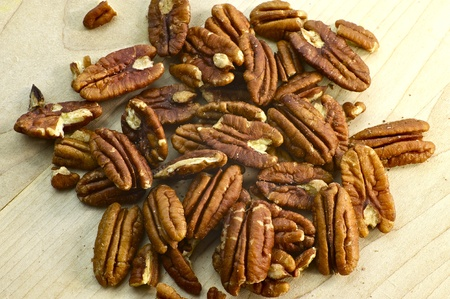 pecan: Fresh Pecans on the Wood Kitchen Board. Organic Photo Collection.