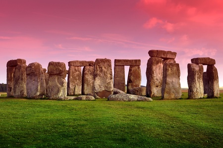 stonehenge:  Stonehenge - Prehistoric Monument Located in the English County of Wiltshire  Archaeologists Have Believed That the Iconic Stone Monument Was Erected Around 2500 BC  Horizontal Photo of Stonehenge in Sunset