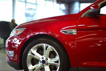 Modern Red Car   Vehicle  Red Car in Dealer Showroom  Front Part  Transportation Photo Collection  Stock Photo