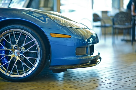 auto dealership: Sport Car for Sale. Blue Sport Vehicle in Dealership Waiting For New Owner. Front of the Vehicle.