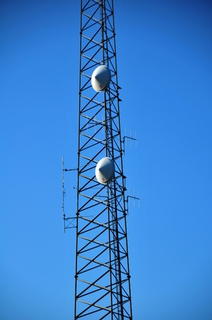 GSM Tower on the Blue Sky. Cellular Tower with Antennas Фото со стока
