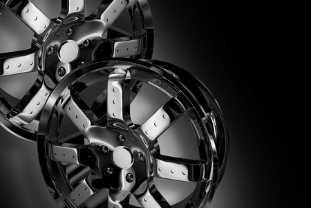 alloy wheel: Two Chrome Wheels - Shiny Chromed Alloy Wheels on Dark-Black Background.  Stock Photo