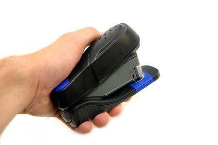 office stapler: Black Plastic Office Stapler in Hand. White Separated Background.
