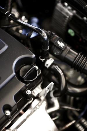 Modern Car Engine. Ecology and Economic Vehicle Technology. Powerful and Economic Modern Car Engine. Brand New Vehicle. Stock Photo - 13239564