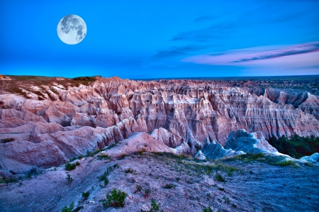 badlands: Badlands Dusk (HDR) with Full Moon on the Sky. Beautiful Scenic Photography. Badlands National Park, U.S.A.