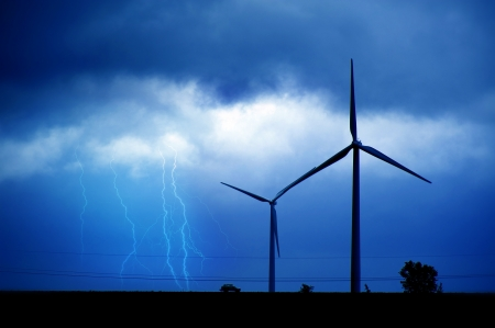 bluish: Wind Turbines and Summer Lightning Storm. Technology and Nature Theme. Bluish Colors.