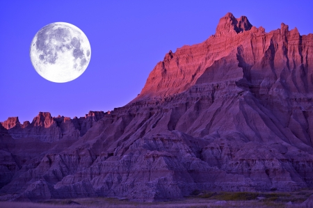 Full Moon in the Badlands National Park, South Dakota, USA. Eroded Moon-Like Sandstones Landscape.