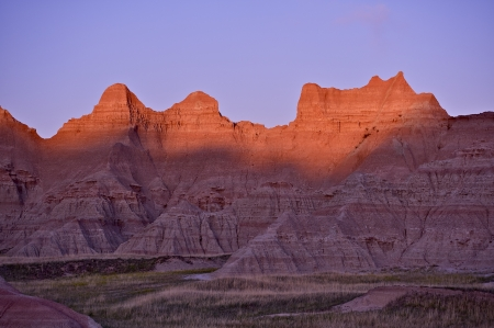 Badlands Sunset. Located in Southwestern South Dakota, Badlands National Park. The Scenery in Badlands National Park is a Mixture of Badlands Formations and Prairie.  photo