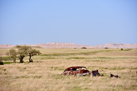 jalopy: Rest in Peace - Automobile Place of Rest. Very Old Rustic Car in a Middle of South Dakotas Prairie. Transportation Photo Collection.