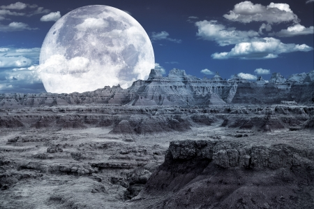 Bad Lands Fantasy - Rocky Moon Like Landscape and Huge Full Moon on the Cloudy Night Sky. Cool Abstract Design. Digital Art photo
