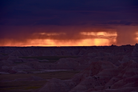 Lightning Between Clouds. Heavy Storm in the Badlands, NP, SD, U.S.A. Sever Storm During Sunset. Severe Weather Photo Collection. photo