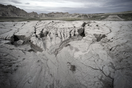 Sandy Badlands Landscape at Evening. Badlands South Dakota. Eroded Sandstones.  photo