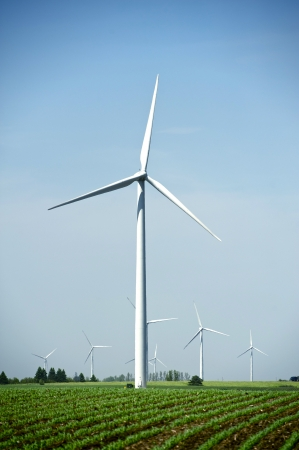 dexter: Wind Energy Technology. Wind Turbines in USA. Vertical Photography.